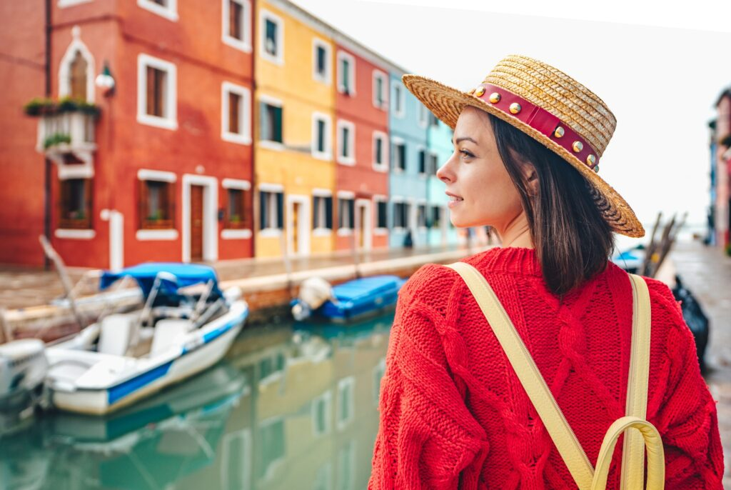 Beautiful girl in a hat in Italy